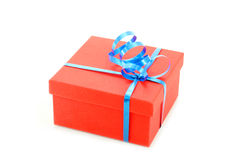 Red gift box. With blue ribbon isolated Stock Images