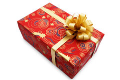 Red gift box. With a golden ribbon on a white background Royalty Free Stock Image