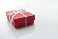 Red gift box. On white table Royalty Free Stock Image