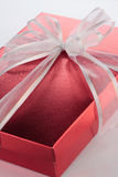 Red gift box. Very nice red present gift box with white ribbon Stock Photo