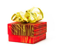 Red gift box. On white background with golden bow Stock Photos