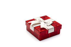 Red gift box. A red gift box with white ribbon, for any occasion Stock Photography