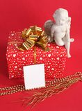 Red gift box with angel Stock Photography