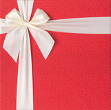 Red gift box with beige bow Royalty Free Stock Photography