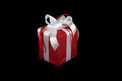 Red gift box on black Stock Images