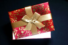 Red gift box on black background.  Royalty Free Stock Image