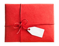 Red gift box with blank gift tag Royalty Free Stock Images