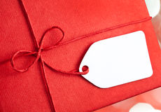 Red gift box with blank gift tag Stock Image