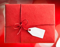 Red gift box with blank  tag Royalty Free Stock Photos