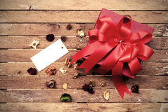 Red gift box with blank tag Stock Photography
