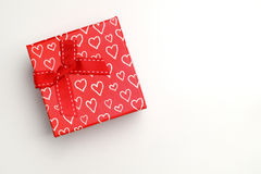 Red gift box with bow and painted hearts isolated top Royalty Free Stock Photography