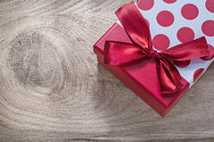 Red gift box with bow on wooden board celebrations concept Royalty Free Stock Image