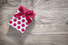 Red gift box with bow on wooden board holidays concept Stock Photo