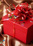 Red gift box with bows and stars Royalty Free Stock Photos