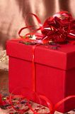 Red gift box with bows and stars Stock Photography