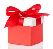 Red gift box and bright cover with bow Royalty Free Stock Photo