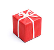 Red gift box with bright ribbon Royalty Free Stock Photography