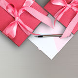 Red gift box with card Royalty Free Stock Photos