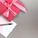 Red gift box with card Stock Images