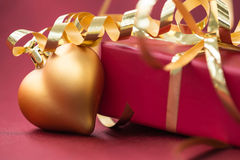 Red gift box and Christmas decorations in the shape of heart Stock Images