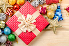 Red gift box and christmas decorations. Royalty Free Stock Image