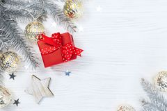 Red gift box and christmas fir tree branches decorated with glow Royalty Free Stock Images