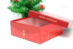 Red gift box and christmas tree Royalty Free Stock Images