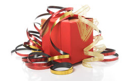 Red gift box with colorful ribbons Stock Image