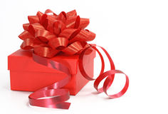 Red gift box with a curly ribb Royalty Free Stock Photo