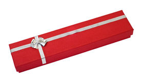 Red gift box cutout. Little red gift box decorated with silver ribbon over white with clipping path Royalty Free Stock Photos