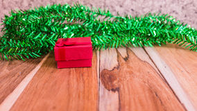 Red gift box decorations for Christmas,New Year and valentine. On a wooden floor. Used for the background Stock Images