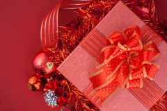 Red Gift box with decorations and color ball on red background Royalty Free Stock Photography