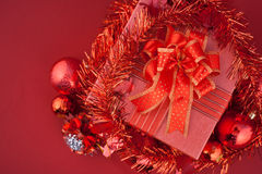 Red Gift box with decorations and color ball on red background Royalty Free Stock Image