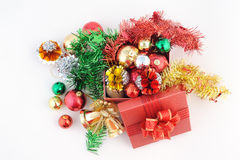 Red Gift box with decorations and color ball on white background Royalty Free Stock Images