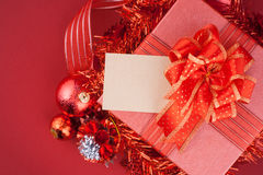 Red Gift box with decorations and color ball on wood Royalty Free Stock Photo
