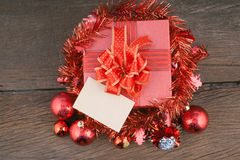Red Gift box with decorations and color ball on wood Stock Photo