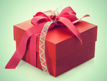 Red gift box with decorative bow Royalty Free Stock Image