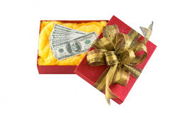 Red gift box. Dollars in red gift box on isolated white background Stock Photo