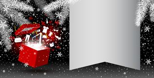Red gift box with fashion icon and firework. On christmas background with copy space Royalty Free Stock Image