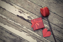 Red gift box with flower and red heart Royalty Free Stock Image