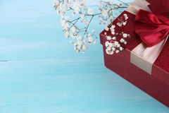 Red gift box and flower wood background. Valentine days Concept and Decoration stock photos