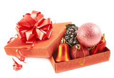 Red gift box full of decorations Stock Photos