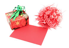 Red gift box and gift card and ribbon bow. On white background Stock Photos