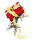 Red gift box with a gold bow Royalty Free Stock Photography