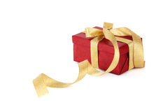 Red gift box with gold bow Royalty Free Stock Images