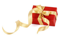 Red gift box with a gold bow Stock Photo