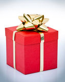 Red gift box with gold bow Royalty Free Stock Image