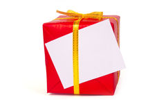 Red gift box with a gold bow Royalty Free Stock Images
