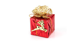 Red gift box and gold Reindeer. Royalty Free Stock Image