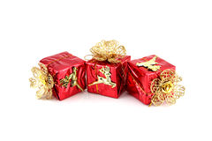Red gift box and gold Reindeer. Royalty Free Stock Photography